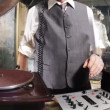 Close-up crops of an older man djing with gramophones — Stock Video