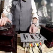 Close-up crops of an older man djing with gramophones - Stock Photo