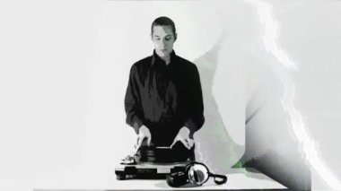 Cool male dj behind the turntables — Stock Video