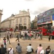 Fisheye timelapse shot infront of eros statue, picadilly circus, london - Stock Photo