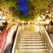 Going up and down a subway entrance in barcelona spain - Stock Photo