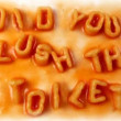 """did you flsuh toilet"" written with alphabetti spaghetti — Wideo stockowe #16984067"