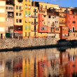 Reflection of the old town of girona, spain, in the river - Stock Photo