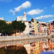 Reflection of the old town of girona, spain, in the river - Foto Stock