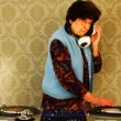 A very funky elderly granny dj! go lady! - Stock Photo