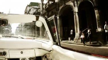 Time-lapse of a havana street scene shot from a classic convertible car — Stock Video