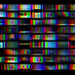 Digital animation of hd screens showing film and tv related static distortion and countdowns - Stock Photo