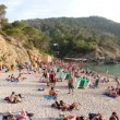 Crowds gather on the famous benirras beach in ibiza - Stockfoto