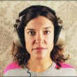 Cute woman wearing different retro headphones - Stok fotoğraf