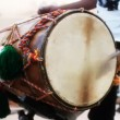 Close-up of man playing the dhol drum - Stock Photo