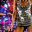 A sexy woman dances in a sparkly disco dress — Stock Video #17429877