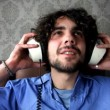 Man listening to music with headphones - 