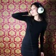 A sexy woman dances with retro white headphones — Vídeo de stock