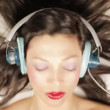 Stock Video: Stop motion of girl's face with lots of different retro headphones