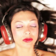 Close-up of a girl listening to music on headphones — Stock Video #17591799