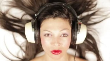 Stop motion of girl's face with lots of different retro headphones — Stock Video