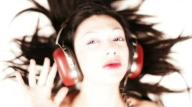 Close-up of a girl listening to music on headphones — 图库视频影像
