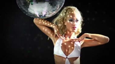 Sexy professional gogo lily malibu shot dancing under a large rotating disco ball — Stock Video