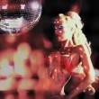 Stock Video: Sexy professional gogo lily malibu shot dancing and next to large spinning discoball