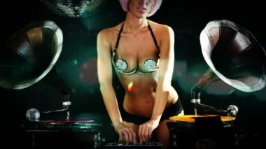 Sexy professional gogo lily malibu shot dancing and posing behind gramophone dj turntables — Stock Video
