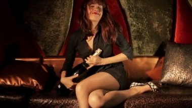 Pin-up girl in a VIP club playing with a large bottle of expensive champagne — Stock Video