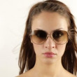 Stopmotion of a pretty woman wearing different retro sunglasses — 图库视频影像