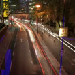 Time-lapse traffic and street scene shot at night in london - Stock Photo