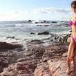 Beautiful girl dances on the beach in a bikini at sunrise — Stock Video