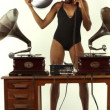 Sexy young woman djs using two retro antique gramophones — Stock Video #18033017