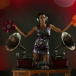 Sexy young woman djs using two retro antique gramophones - 