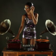 Sexy young woman djs using two retro antique gramophones — Stock Video