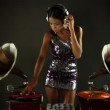 Sexy young woman djs using two retro antique gramophones - Stock Photo