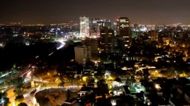 A panning time-lapse of the mexico city skyline at night — Stock Video #18059135