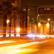 Rush of night time traffic on motorway in timelapse scene - 图库照片