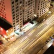 Time-lapse looking down onto a new york street of fast moving traffic at night - Stock Photo