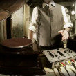 Close-up crops of older mdjing with gramophones — Stockvideo #18476695