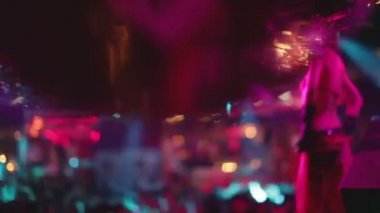 Abstract shot of in a nightclub, shot close to a glitterball — Stock Video