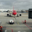 Stock Video: Airplane arriving into terminal at zurich airport