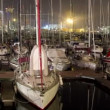 Panning timelapse in barcelona's port vell at night — Stok video