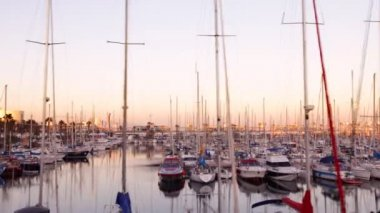 Boats at sunset in a port in Barcelona, spain — Stock Video