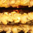 Whole chickens roasting in a shop oven, mexico - Stock Photo