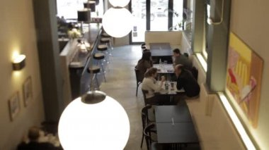 A timelapse shot during the dinner period of a busy stylish restaurant — Stock video