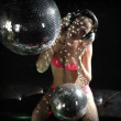 A sexy gogo dancer shot in a studio dancing and posing with a spinning discoball — Stock Video #18778935