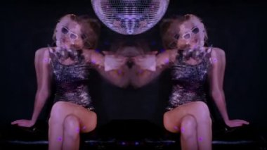 A sexy gogo dancer shot in a studio dancing and posing with a spinning discoball — Stock Video