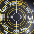 Close-up of the circular radio dial of an old retro radio - Stock Photo