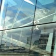 Reflection of st pauls cathedral in glass window - Stock Photo