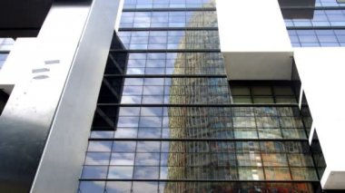 The torres agbar building in barcelona reflected in another building