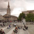 On steps of trafalgar square, london - Stock Photo