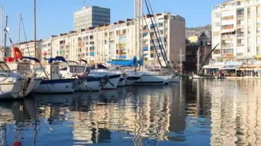 Boats and yachts moored in the picturesque harbour of toulon — Stock Video