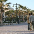 Walking along the broadwalk at valencia's beach - ストック写真
